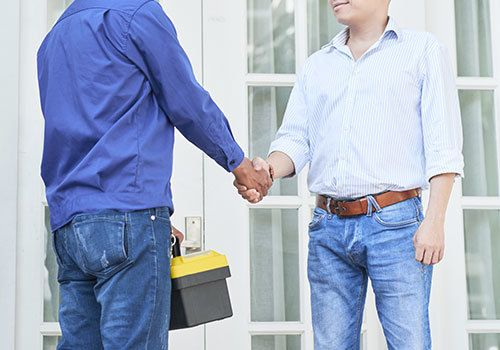 Service technician shaking hands with a customer