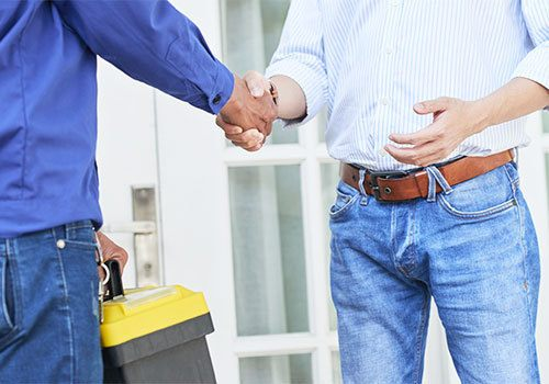 Service technician shaking hands with a customer leaving an appointment